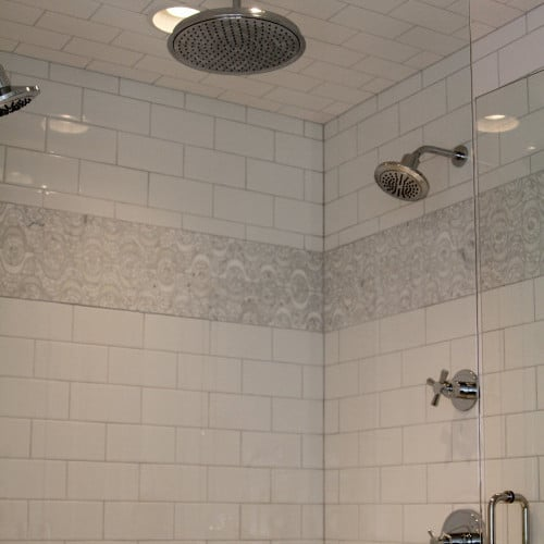 The Bathroom S New Shower Features Mirabelle Chrome Hardware On Neutral Field Tile With An Accent