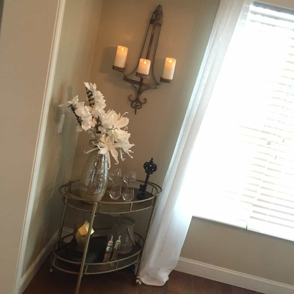 """Metallic accents, flowers and candles are romantic touches that give the room a """"wow"""" factor and fill the void of an empty corner"""