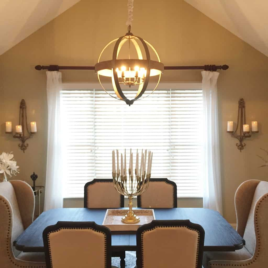 The chandelier hangs in the dining room over a gold-plated candelabra with 20 arms. Sconces were placed on each side of the window to bring more touches of candlelight to the dining setting
